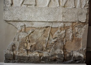 Tiglath-pileser_III_stands_over_an_enemy,_bas-relief_from_the_Central_Palace_at_Nimrud.