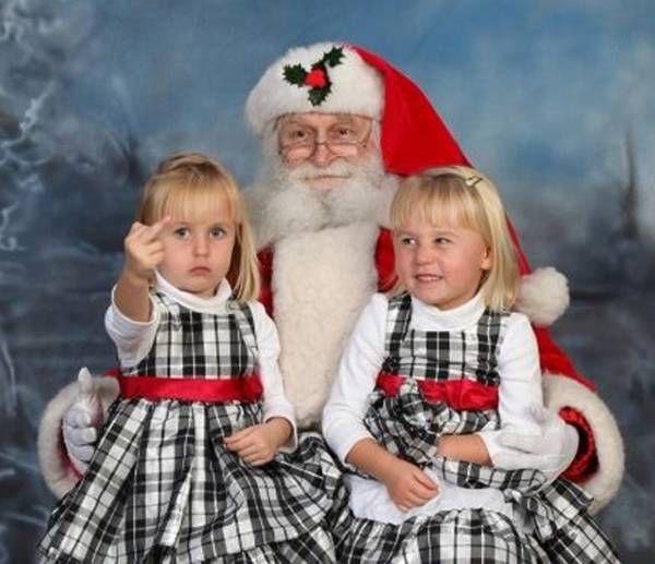 Cute Little Girl On Santa Flicking Off Camera