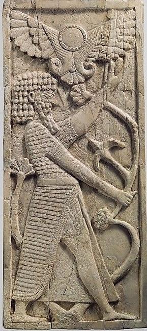 Winged sun over Ashurnasirpal II at Nimrud