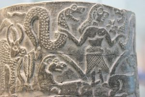 Ishtar in the Sumerian creation myth, with two snakes and a 6 pointed star and lions