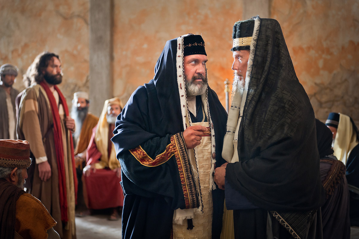 Pharisees debating what to do with Peter and John